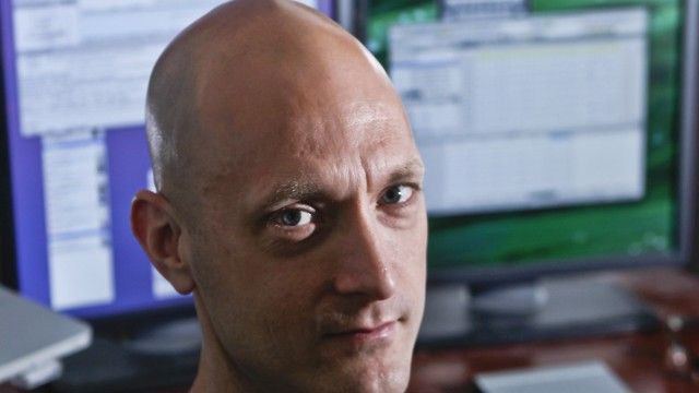 Security researcher Charlie Miller sits in his home-office in Wildwood, Missouri