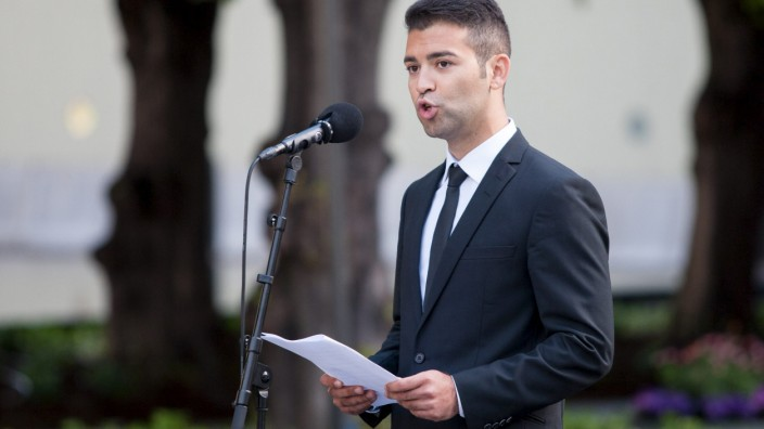 Hussaini, leader of the AUF youth wing of the Labour Party, speaks during a memorial ceremony near the government building which was bombed by gunman Anders Behring Breivik in Oslo