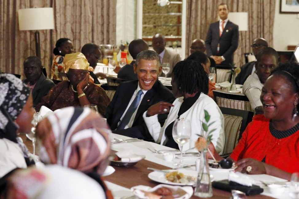 U.S. President Barack Obama attends a private dinner with family members at his hotel restaurant after arriving in Nairobi