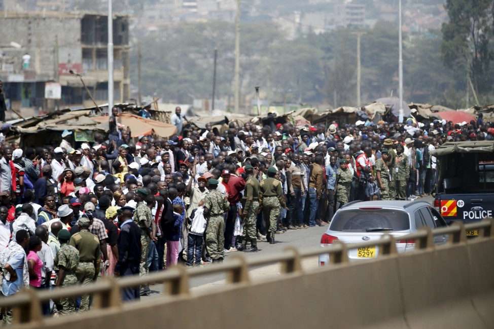 Crowds line the motorcade route as Obama travels to deliver remarks at an indoor stadium in Nairobi