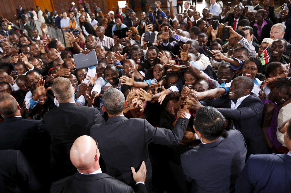 The crowd surges toward Obama as he greets the audience after his remarks at an indoor stadium in Nairobi