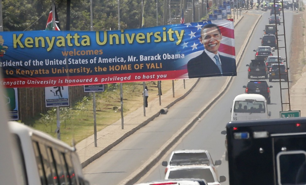 Obama's motorcade travels down the road after his remarks at an indoor stadium in Nairobi