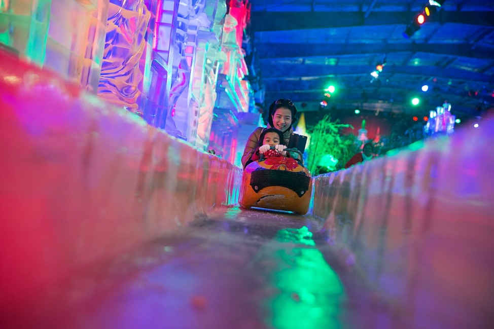 Locals Take A Break From The Heat In Bangkok's New Snow Town Park