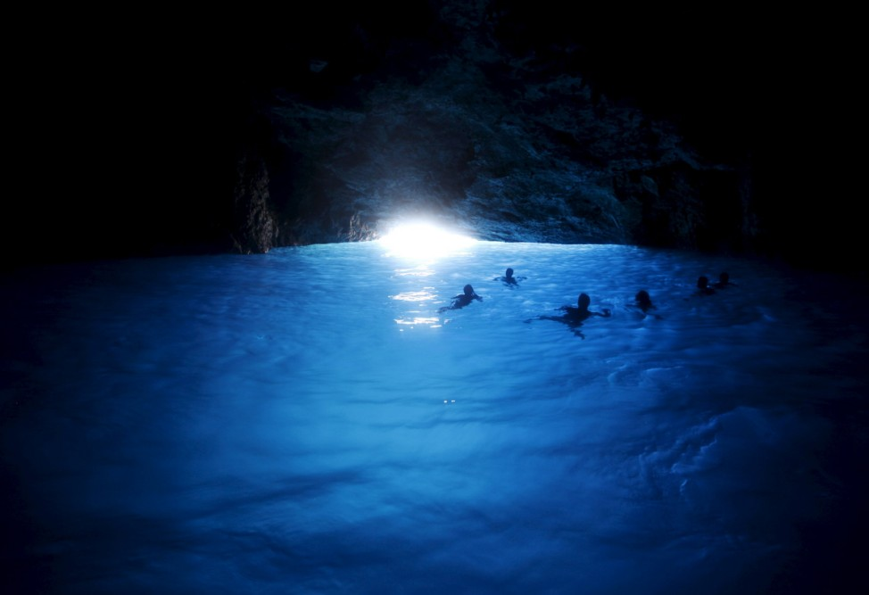Tourists swim inside the Blue Cave of the island of Kastellorizo, Greece's easternmost island