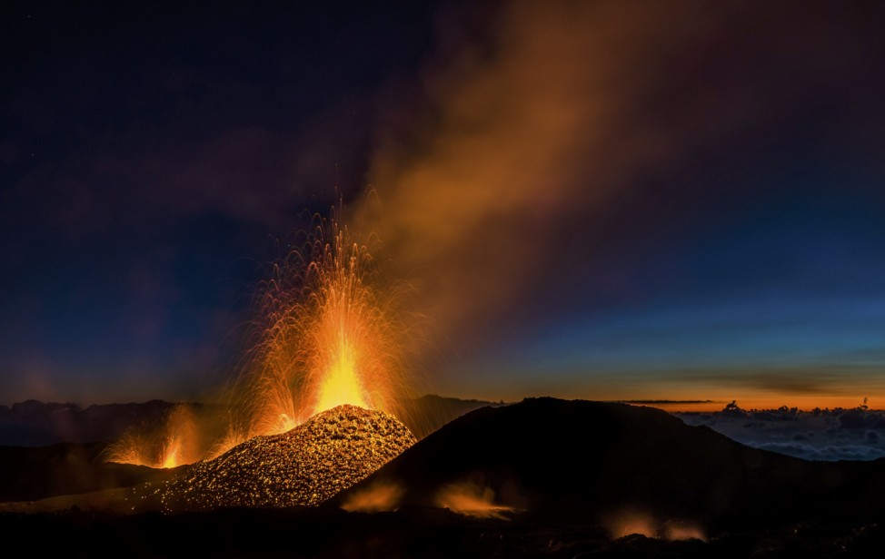 Molten lava erupts from the Piton de la Fournaise, one of the world's most active volcanoes, on the Indian Ocean Reunion Island
