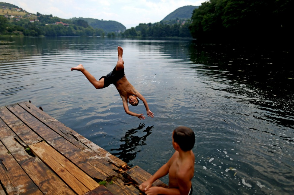 Boys jump into a lake in the central Bosnian town of Jajce