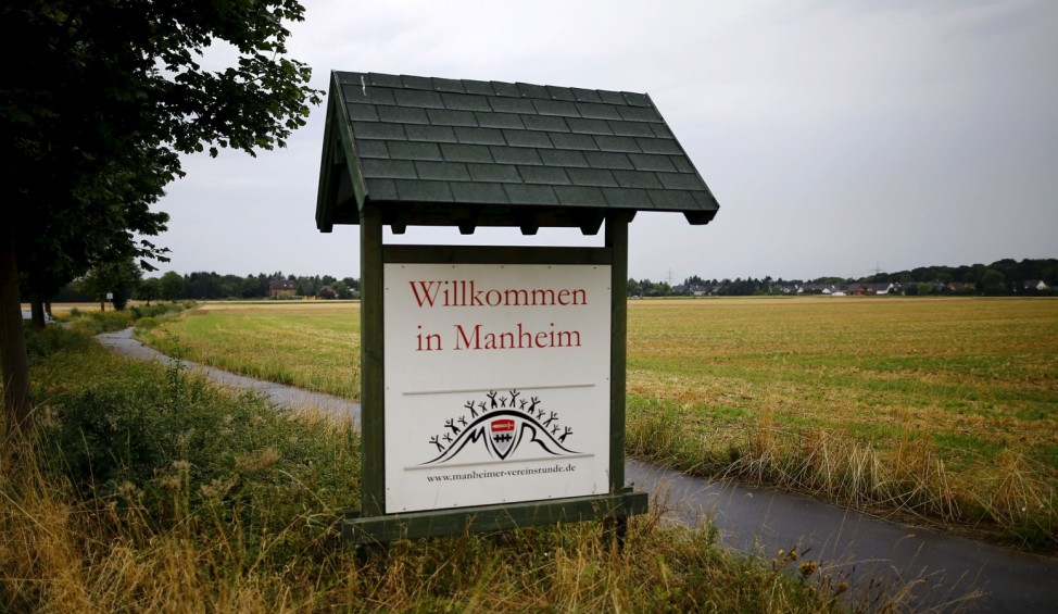 A Welcome sign is seen at the village entrance of Kerpen Manheim