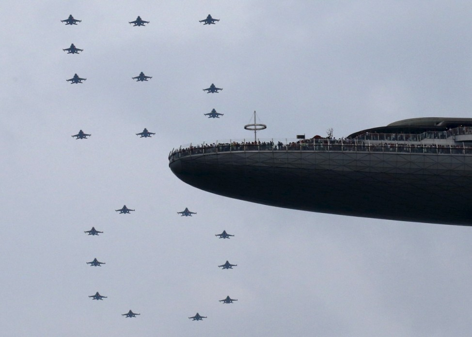 The Republic of Singapore Air Force performs a '50' formation during an aerial display in Singapore's Golden Jubilee celebrations near the central business district