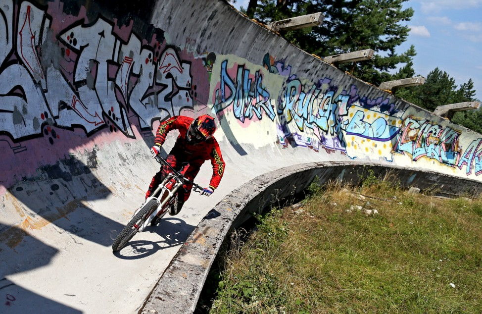 Downhill biker Mulic trains on the disused bobsled track from the 1984 Sarajevo Winter Olympics on Trebevic mountain near Sarajevo