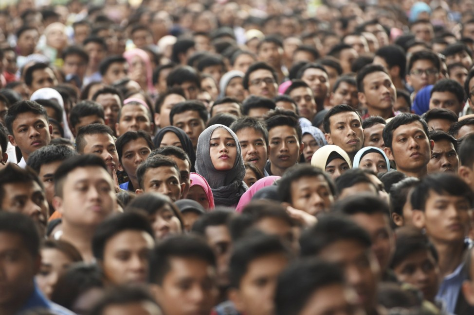 Ten of thousands job seekers wait outside Gelora Bung Karno stadium to enter for a job fair in Jakarta, Indonesia