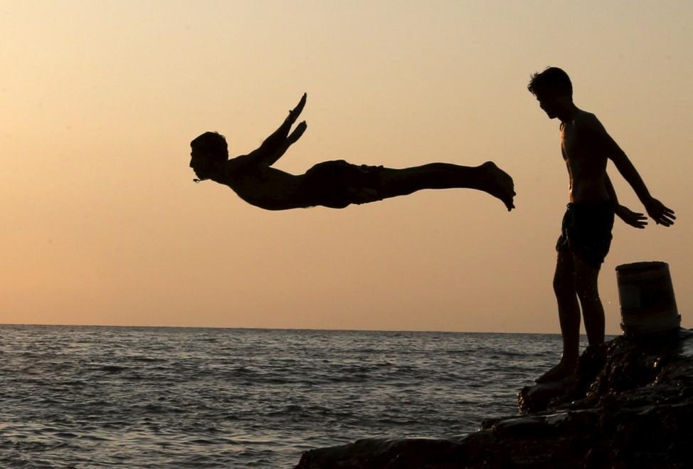 A man dives into the sea in Beirut, Lebanon
