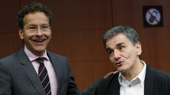 Eurogroup President Dijsselbloem and Greek Finance Minister Tsakalotos attend a euro zone finance ministers meeting in Brussels