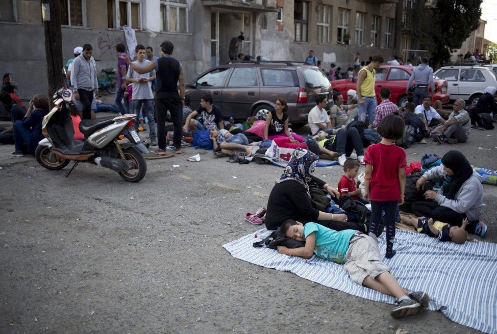 Migrants rest at Gevgelija train station in Macedonia