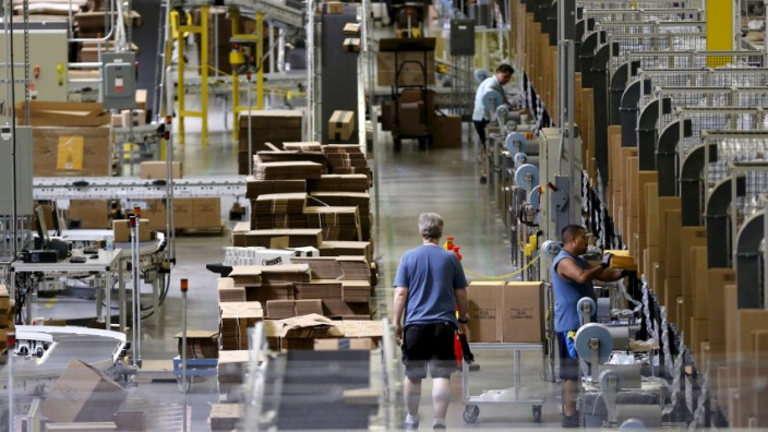 Workers sort products at an Amazon Fulfilment Center in Tracy