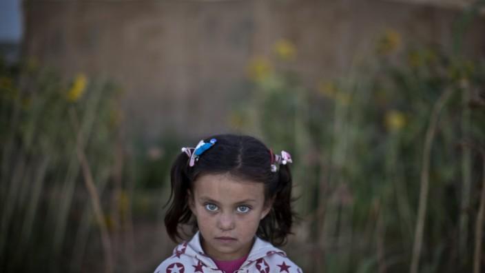 Flüchtlinge in Jordanien: Ein syrisches Flüchtlingsmädchen in Jordanien. In dem Nachbarstaat leben 600 000 Flüchtlinge oft in extremer Not.
