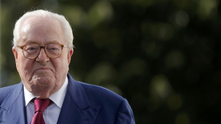 French far-right National Front founder Jean-Marie Le Pen arrives for a news briefing at the end of a hearing of the executive committee of the party at their headquarters in Nanterre
