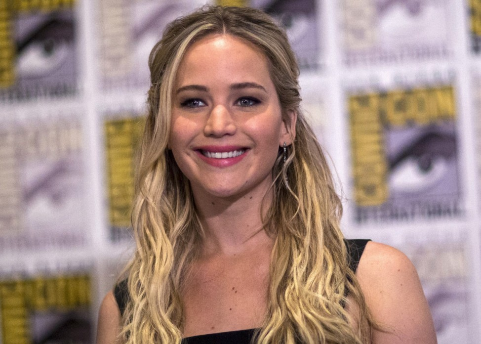 Cast member Lawrence poses at a press line during the 2015 Comic-Con International Convention in San Diego