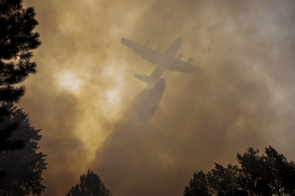 Airplane drops fire retardant on the Twisp River fire near Twisp, Washington