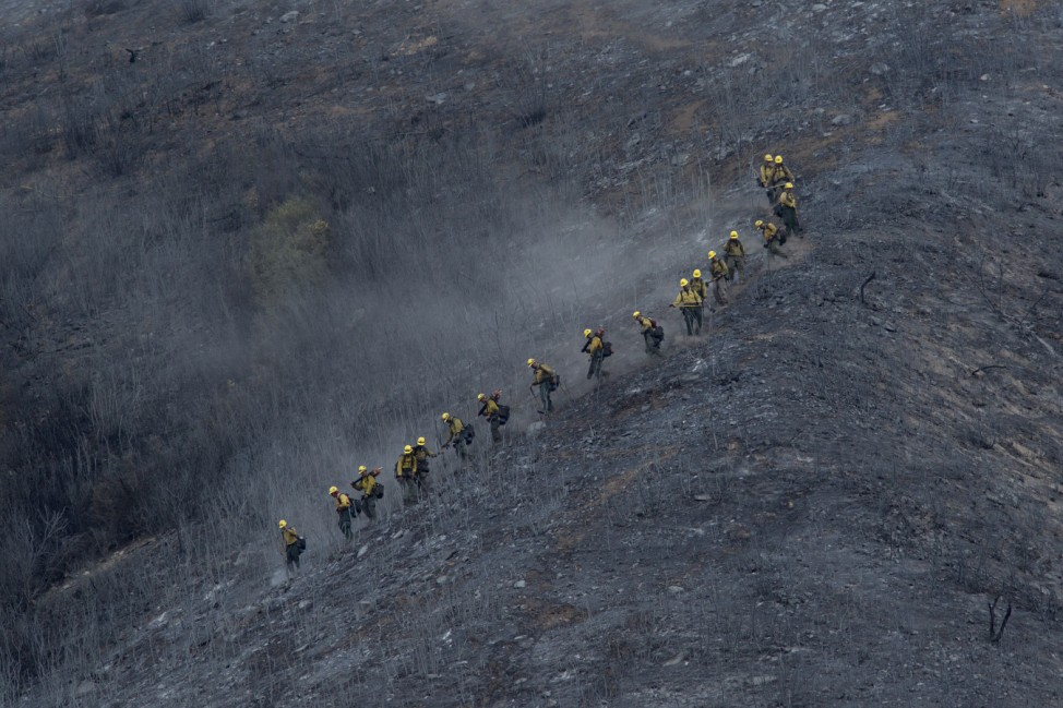 Fire Crews Work To Contain Cabin Wildfire Within Angeles National Forest