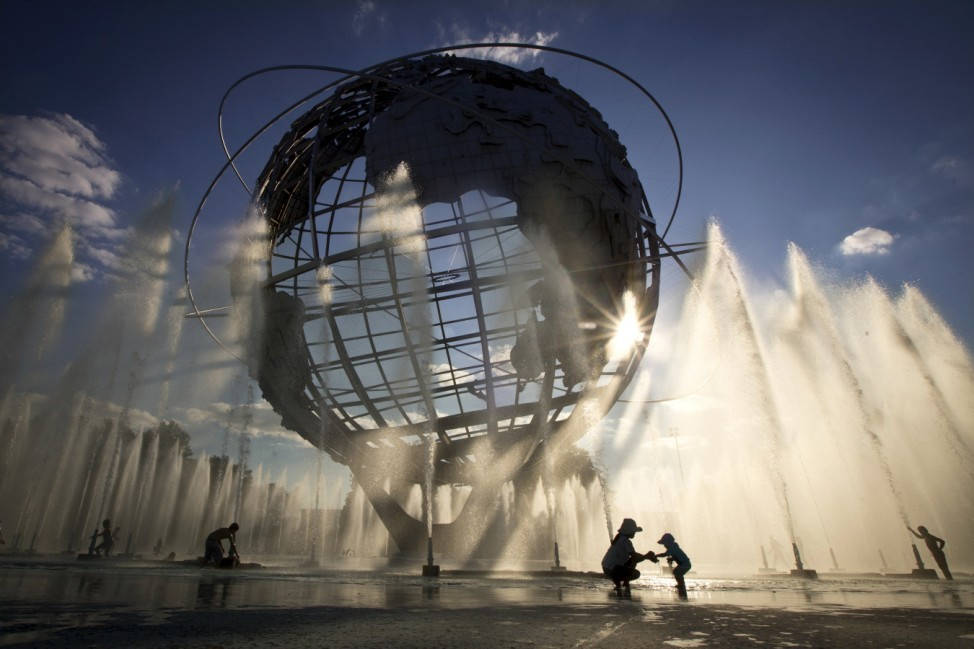 The Unisphere is pictured in the late day sun as people play in the water just outside the grounds of the U.S Open tennis championships in the Queens borough of New York