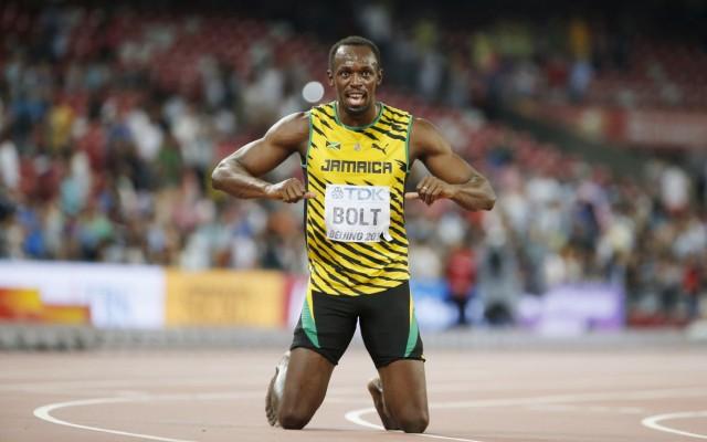 Usain Bolt of Jamaica celebrates after winning the men's 200m final during the 15th IAAF World Championships at the National Stadium in Beijing, China