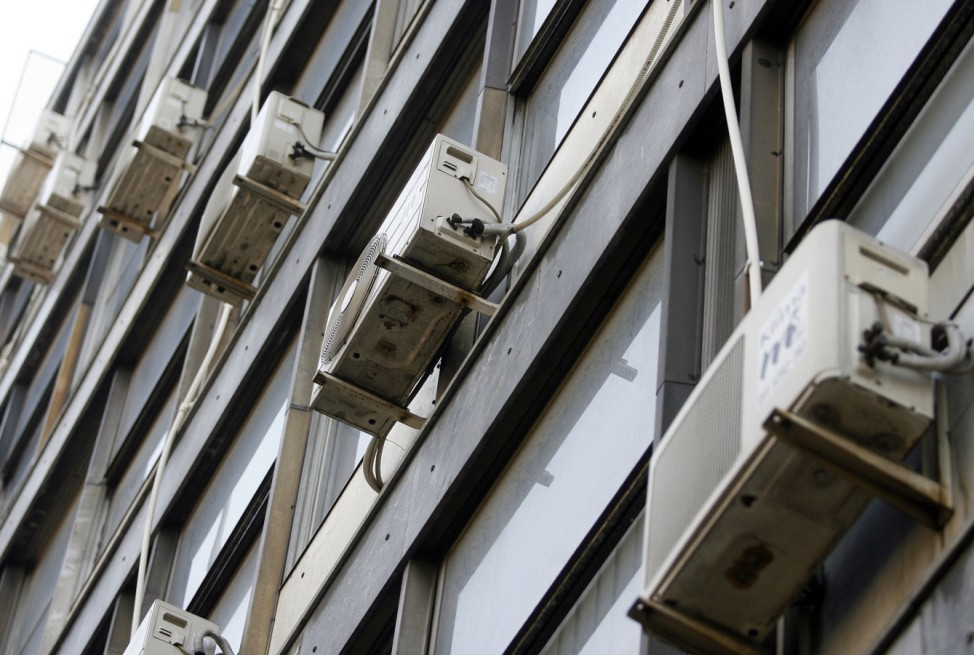 External air conditioners are seen fitted to the exterior of a building in central Belgrade