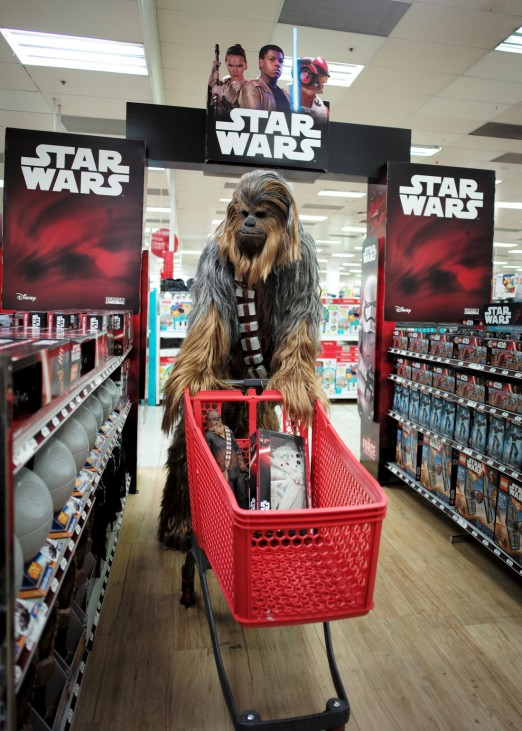 A fan dressed as Chewbacca shops for merchandise from the upcoming film 'Star Wars: The Force Awakens' just before midnight on 'Force Friday' in Sydney