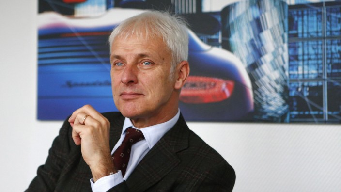 Mueller, CEO of German sports car manufacturer Porsche answers reporter's questions during an exclusive interview with Reuters at the Porsche headquarters in Stuttgart