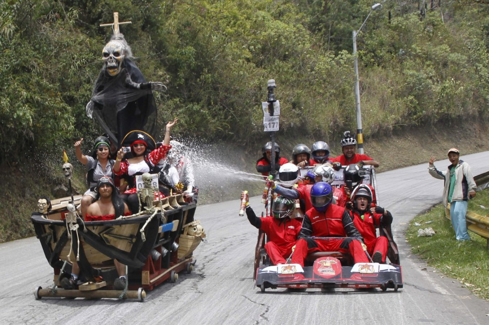 Participants descend a hill on a homemade cart during the 26th Roller Cart Festival in Medellin