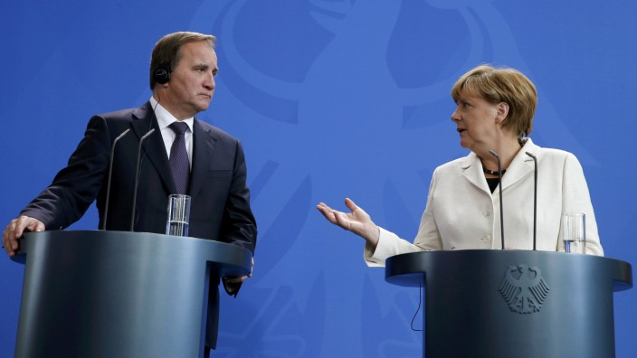 Swedish Prime Minister Lofven and German Chancellor Merkel address a news conference at the Chancellery in Berlin