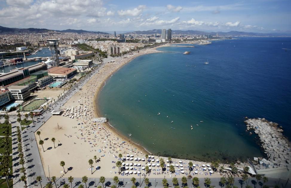 People cool off at Sant Sebastia beach in Barceloneta neighborhood in Barcelona