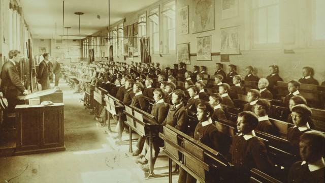 Boys sitting at their desks, Ashford Residential School, Middlesex, 1900. Artist: Unknown.