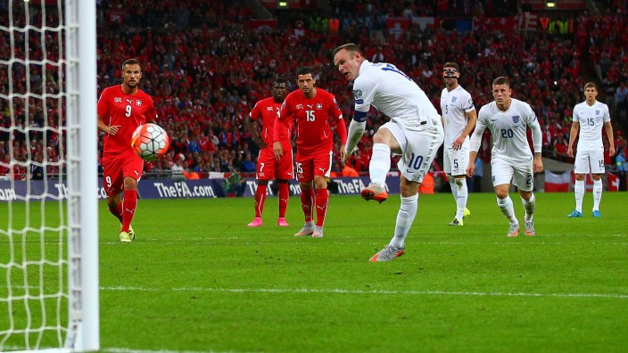 Wayne Rooney of England scores a goal to make the score 2 0 from a penalty to become England s leadi