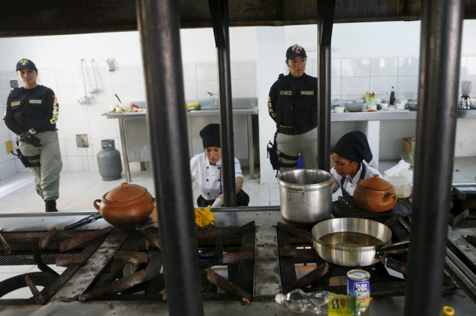 Inmates cook food during a culinary competition at the Santa Monica female prison in Lima