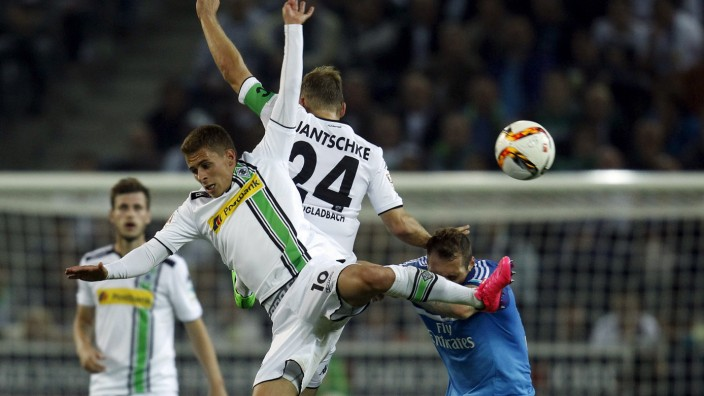 Hamburger SV's Lasogga and Borussia Moenchengladbach's Hazard and Jantschke jump for a ball during their Bundesliga first division soccer match in Moenchengladbach