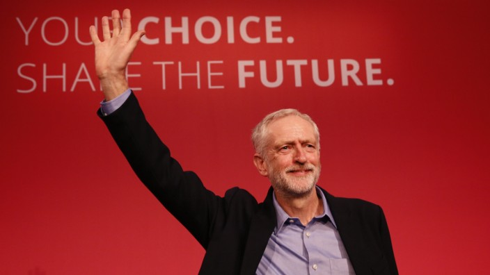 The new leader of Britain's opposition Labour Party Jeremy Corbyn waves after making his inaugural speech at the Queen Elizabeth Centre in central London