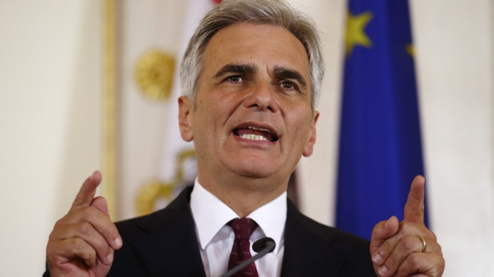 Austrian Chancellor Faymann addresses a news conference during a break of a government summit on migration policy in Vienna