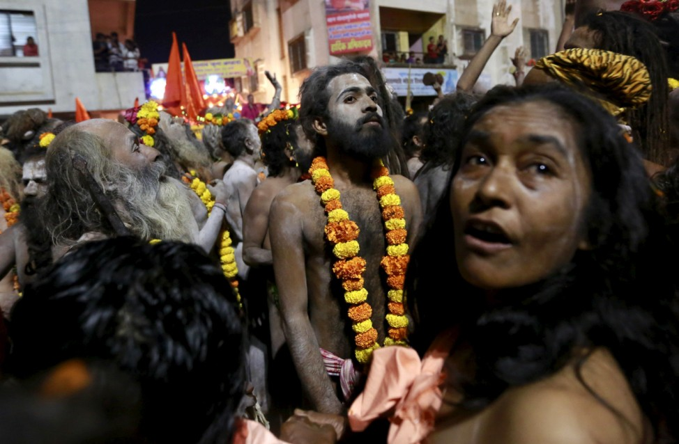 Naga Sadhus, or Hindu holy men, attend a procession before taking a dip in a holy pond during the second 'Shahi Snan' (grand bath) at 'Kumbh Mela', or Pitcher Festival, in Trimbakeshwar