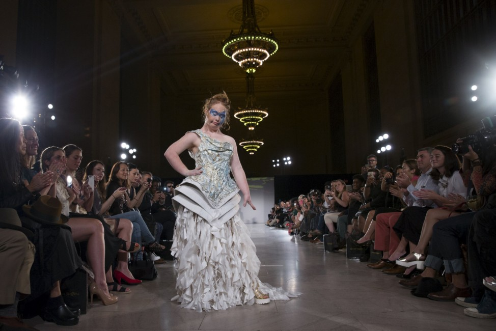 Madeline Stuart, an Australian model with Down Syndrome, presents a creation from the Hendrik Vermeulen label during the FTL Moda presentation of the Spring/Summer 2016 collection during New York Fashion Week in Vanderbilt Hall at Grand Central Station