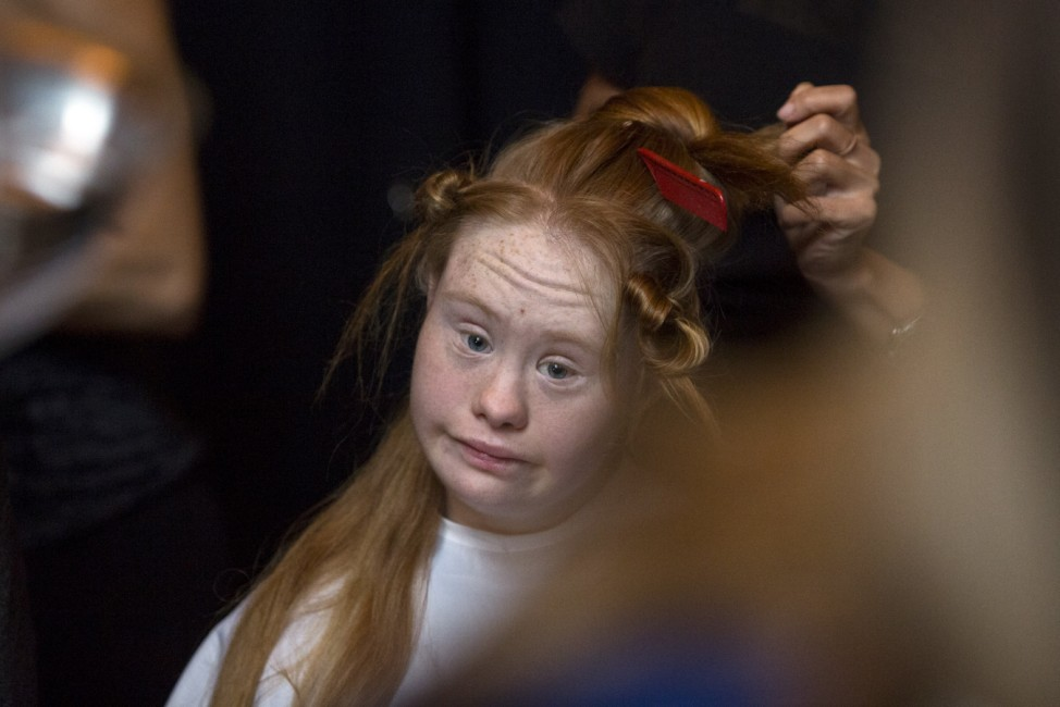 Madeline Stuart, an Australian model with Down Syndrome, is prepared backstage before the FTL Moda Presentation of the Spring/Summer 2016 collection during New York Fashion Week in Vanderbilt Hall at Grand Central Station, New York