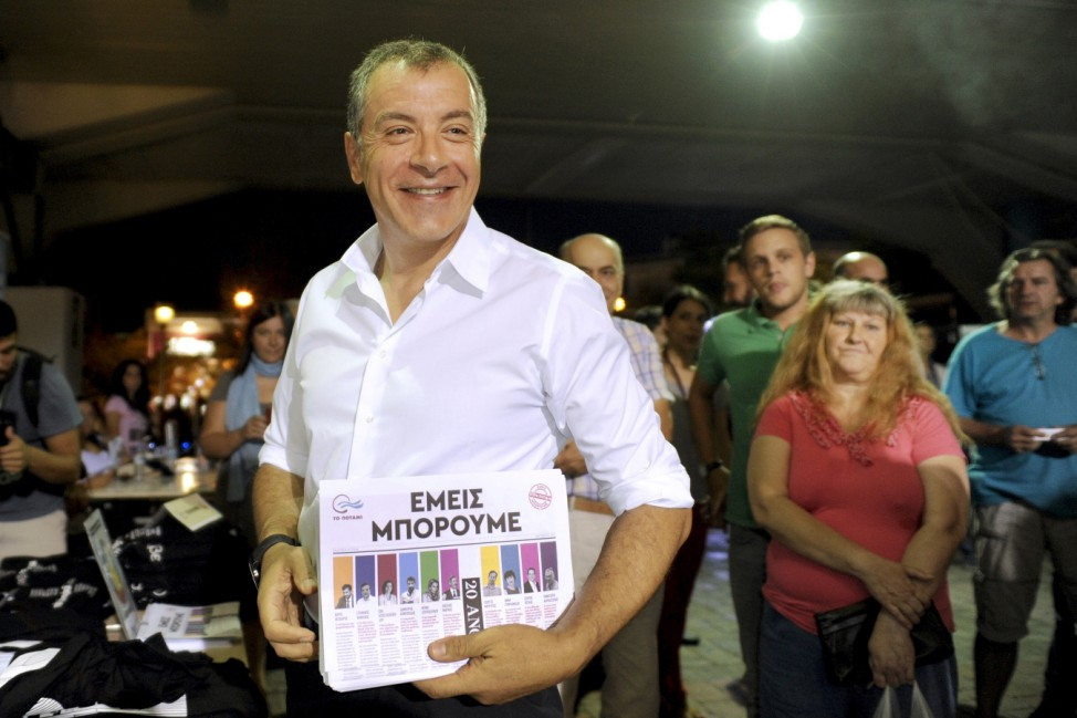 Leader of the centre-left To Potami party Theodorakis holds pre-election material before a rally in Athens