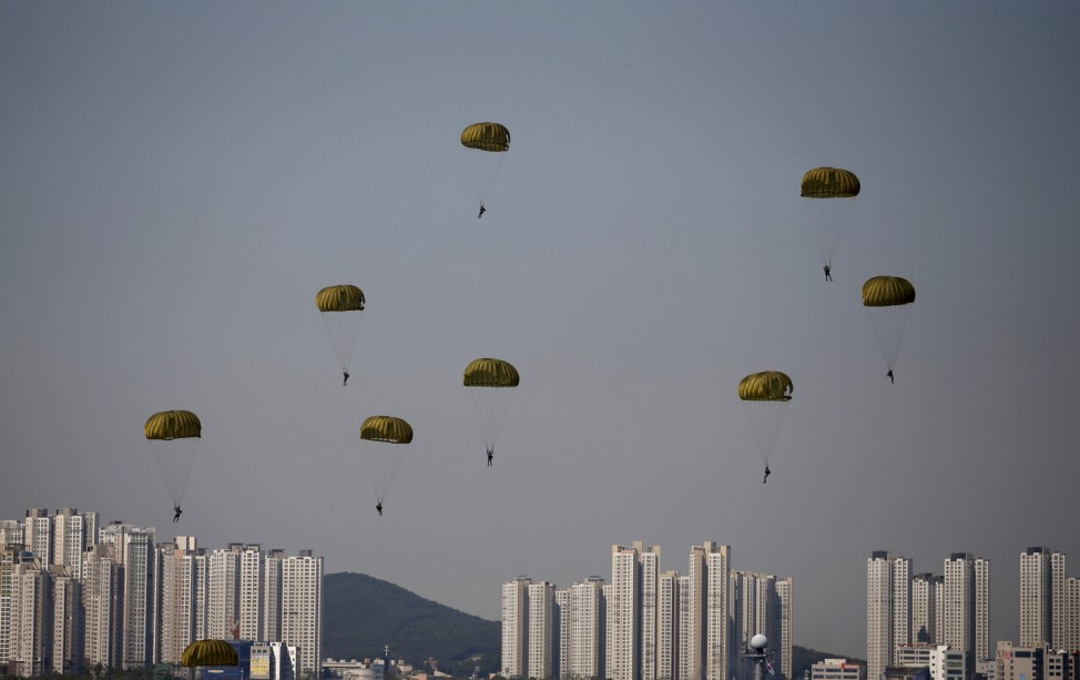 Members of the South Korea Navy Special Warfare parachute down during a ceremony to mark the 65th anniversary of Incheon Landing Operations in South Korea