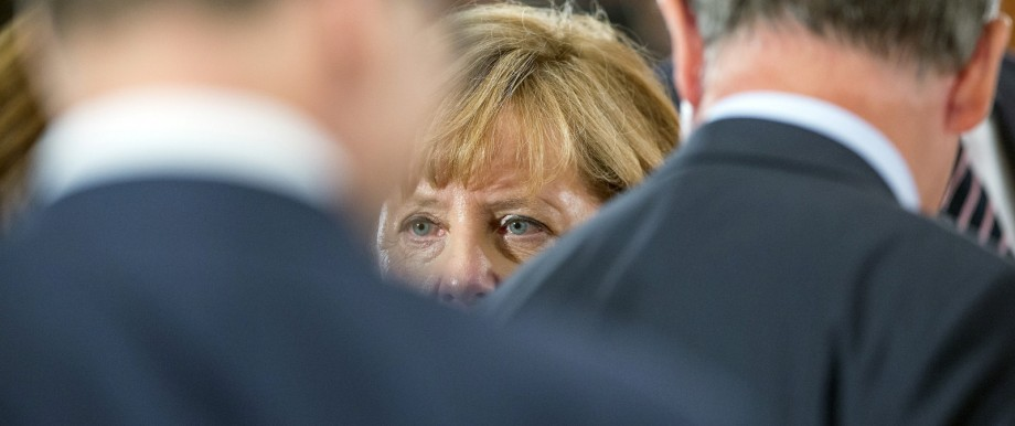 German Chancellor Merkel arrives for a meeting of German state leaders to discuss the migrant crisis at the chancellery in Berlin