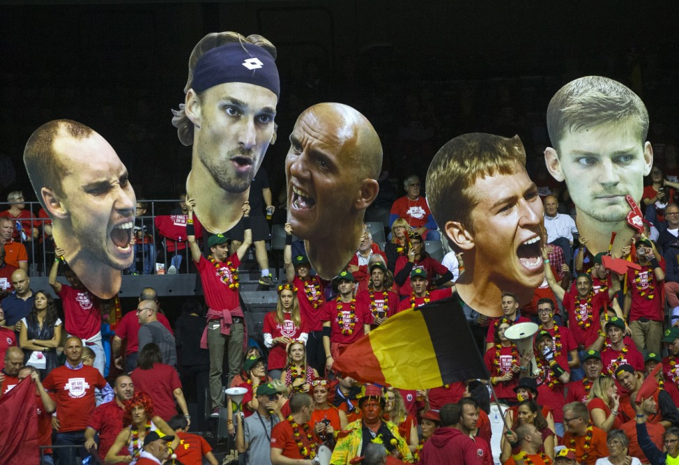 Fans hold up giant portraits of Belgium's Davis Cup team during their semi-final match of the Davis Cup against Argentina at Forest National arena in Brussels