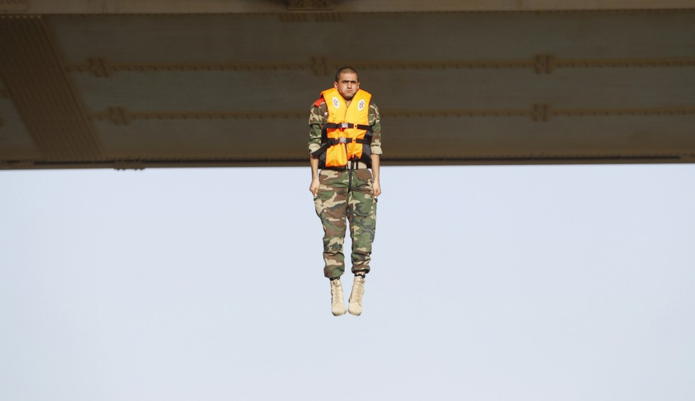 Iraqi army cadet performs 'the leap of faith' from a bridge in Baghdad