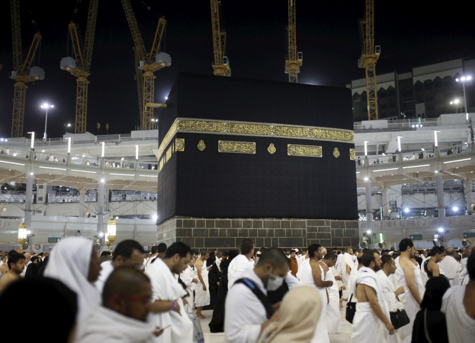 Muslim pilgrims pray around the holy Kaaba at the Grand Mosque on the first day of Eid al-Adha during the annual haj pilgrimage in Mecca