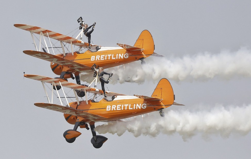 Breitling Wingwalkers aircrafts perform during an aerobatic display at an air show in Zhengzhou