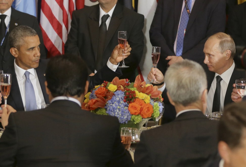 Russian President Vladimir Putin and U.S. President Barack Obama share a toast during the luncheon at the United Nations General Assembly in New York