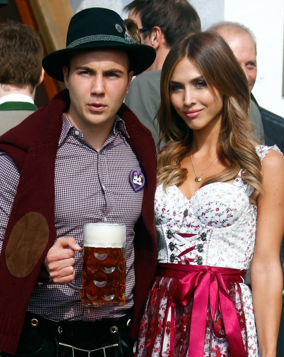 Goetze of German Bundesliga first division club FC Bayern Munich and his girlfriend Broemmel pose as they arrive at the Oktoberfest in Munich