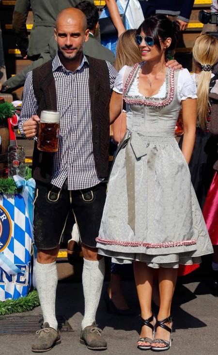 Bayern Munich's coach Guardiola and his wife Cristina arrive at the Oktoberfest in Munich